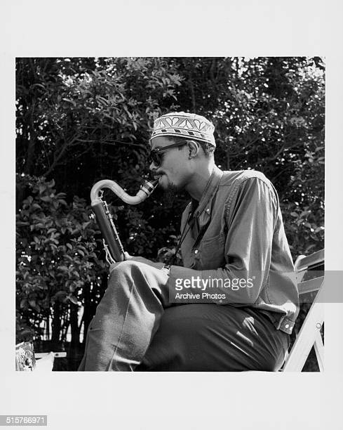 Saxophonist Eric Dolphy performing at 'Tentsville' the rebel camp of musicians established by bassist Charles Mingus in front of the Cliff Walk Manor...