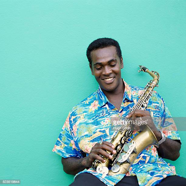 saxophonist in hawaiian shirt - hugh sitton stock pictures, royalty-free photos & images