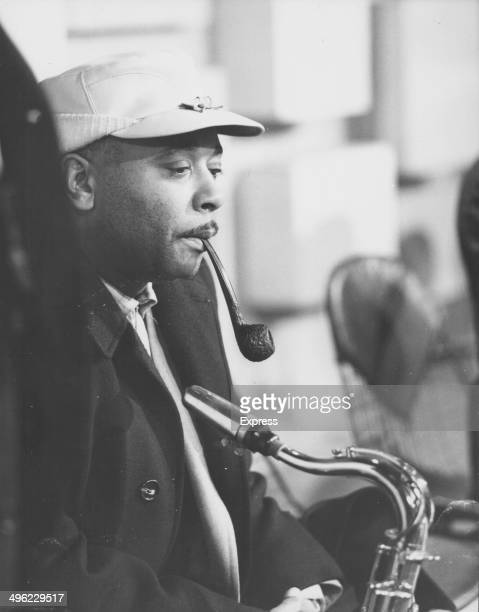 Saxophonist Johnny Hodges smoking a pipe and holding his saxophone England January 28th 1963