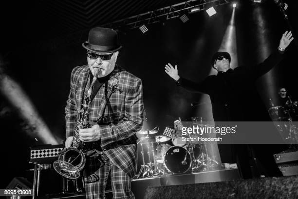 Saxophonist Lee Thompson and singer Graham McPherson of Madness perform live on stage during a concert at Tempodrom on November 2 2017 in Berlin...