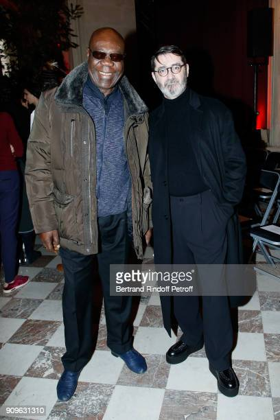 Saxophonist Manu Dibango and Stylist Franck Sorbier attend the Franck Sorbier Haute Couture Spring Summer 2018 show as part of Paris Fashion Week on...