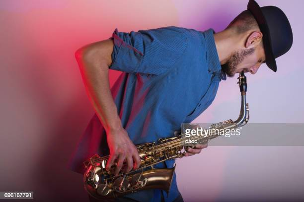 Saxophonist playing his saxophone