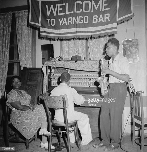 Saxophonist playing with pianist Howard Hayes, one of the leading popular musicians of Monrovia, at the Yarngo Bar in Monrovia, Liberia, 1947.