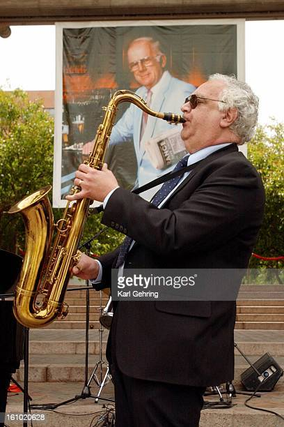 Saxophonist Rich Chiaraluce played Fly Me to the Moon at the conclusion of a ceremony honoring the life of longtime Denver writer Gene Amole Amole...