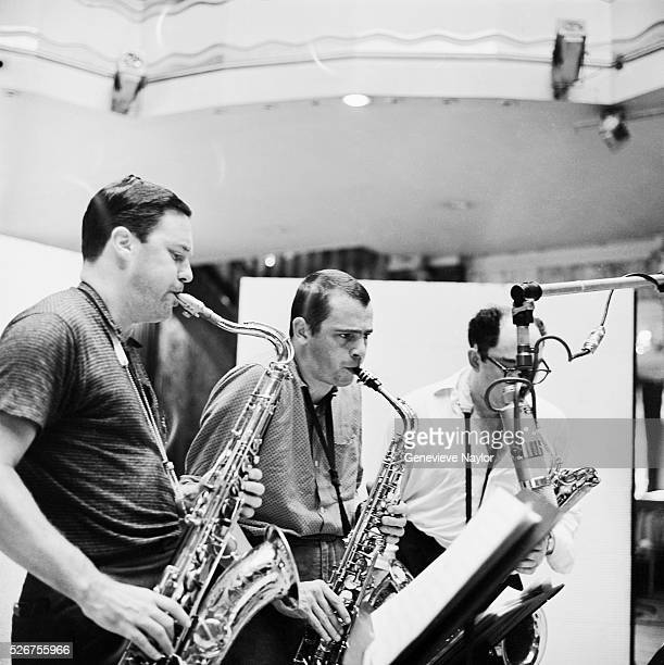 Saxophonists Pepper Adams and Phil Woods play for a recording session of Kai Ole, a release by trombonist Kai Winding.