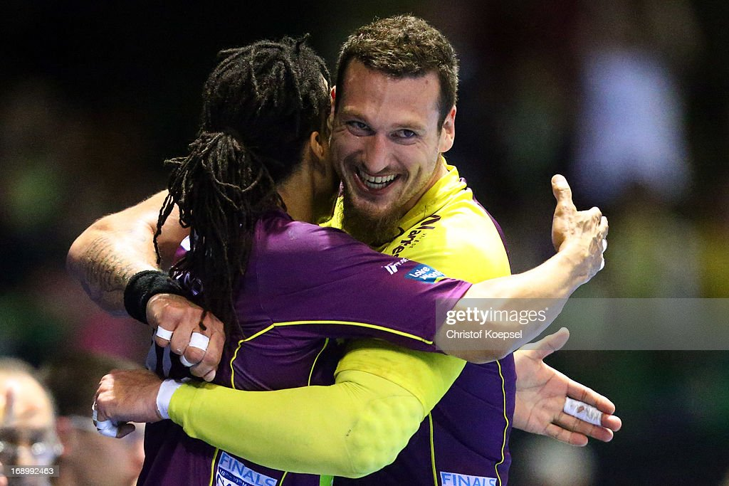 Sayad Seufyann and Borja-Vidal Fernandez of Nantes embrace after winning the EHF Cup Semi Final match between Tvis Holstebro and HBC Nantes at Palais des Sports de Beaulieu on May 18, 2013 in Nantes, France.