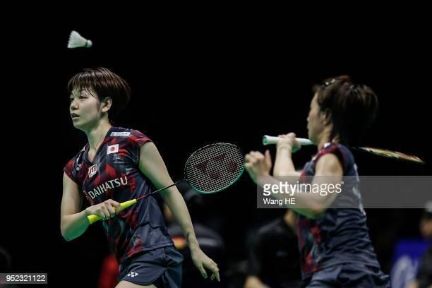 Sayaka Hirota of Japan hits a return and her partner Yuki Fukushima during doubles Semi final match against Della Destiara Haris and Rizki Amelia...