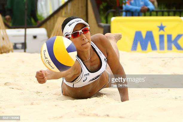 Sayaka Mizoe of Japan dives for the ball during her match against Kim Dicello and Kendra Vanzwieten of the USA during day 4 of the 2016 AVP...
