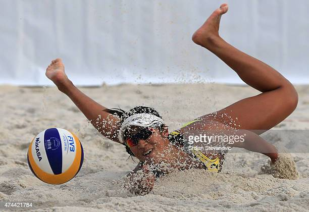 Sayaka Mizoe of Japan dives for the ball during the match between Barbara Hansel and Stefanie Schwaiger of Austria against Shinako Tanaka and Ayumi...