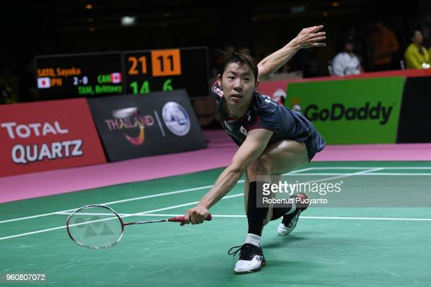 Sayaka Sato of Japan competes against Brittney Tam of Canada during Preliminary Round on day two of the BWF Thomas Uber Cup at Impact Arena on May 21...