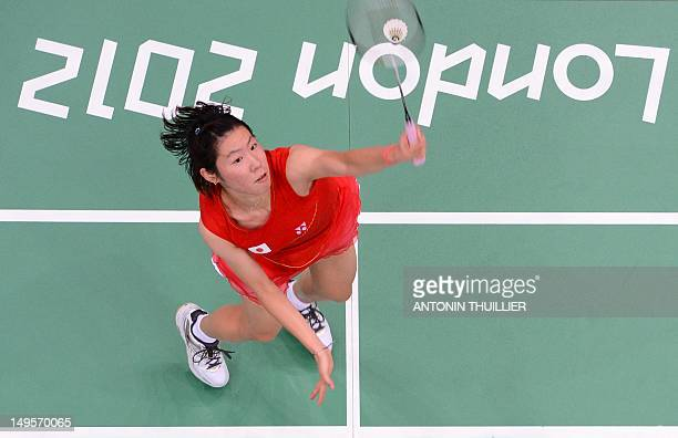 Sayaka Sato of Japan plays a smash during her women's singles badminton match against Susan Egelstaff of Britain in London on July 31 for The 2012...
