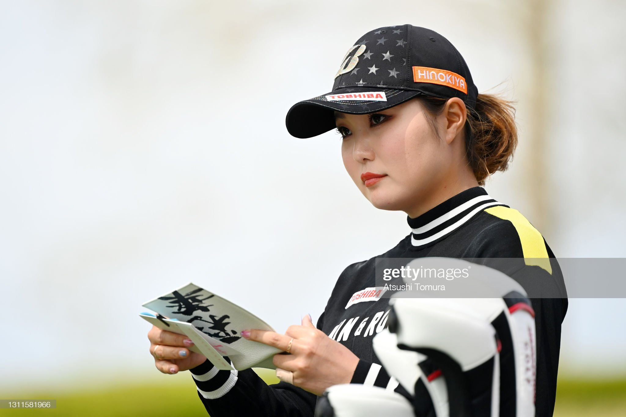 https://media.gettyimages.com/photos/sayaka-takahashi-of-japan-checks-her-yardage-book-on-the-1st-tee-the-picture-id1311581966?s=2048x2048