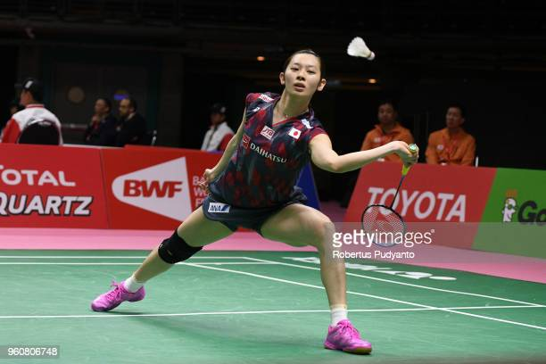 Sayaka Takahashi of Japan competes against Catherine Choi of Canada during Preliminary Round on day two of the BWF Thomas Uber Cup at Impact Arena on...