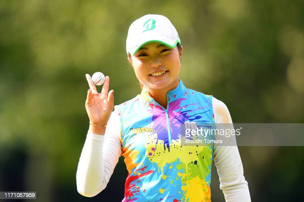 Sayaka Takahashi of Japan poses with the ball as she makes the eagle on the 5th green during the second round of the Nitori Ladies at Otaru Country...