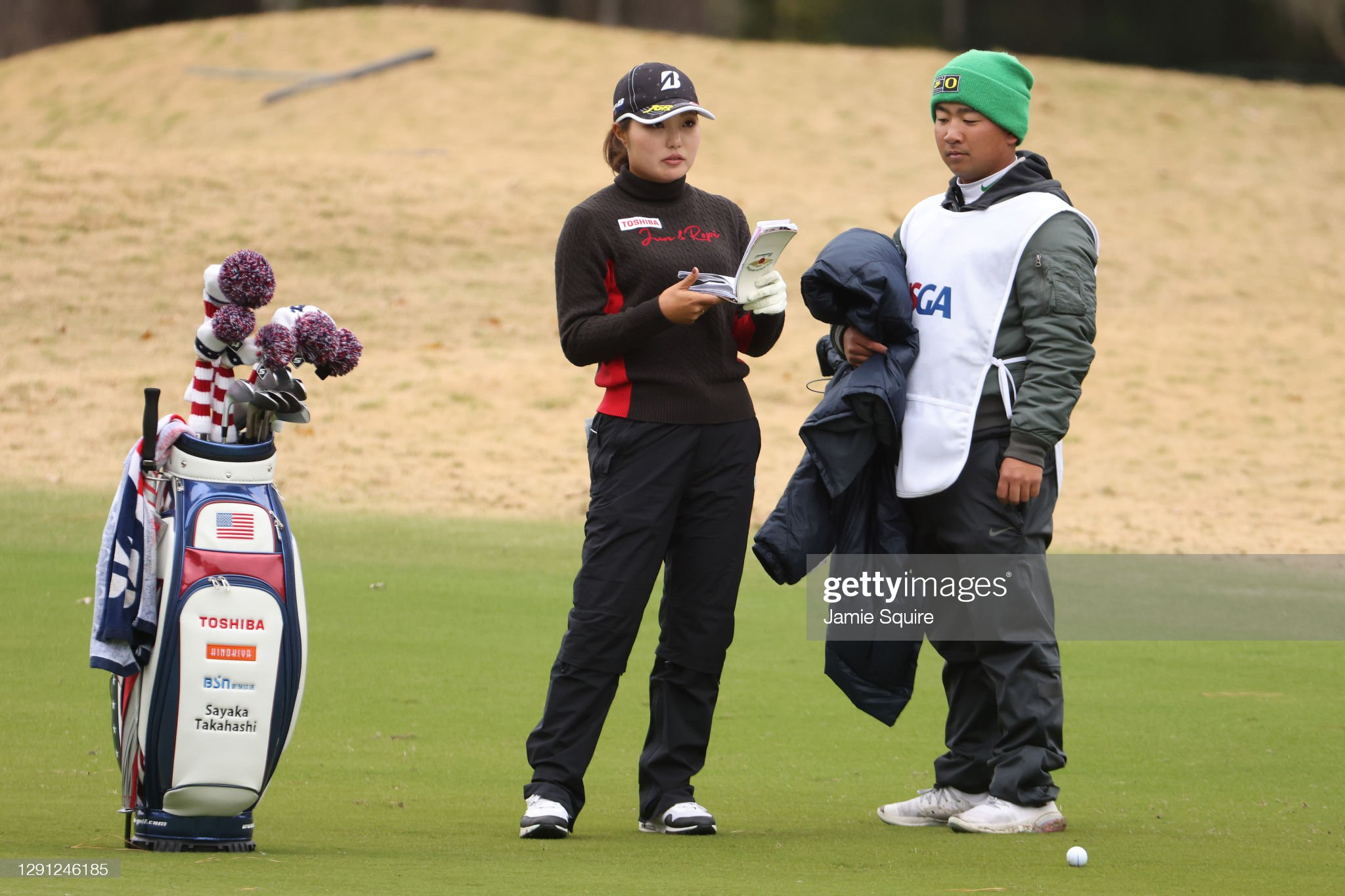 https://media.gettyimages.com/photos/sayaka-takahashi-of-japan-talks-with-her-caddie-on-the-18th-hole-the-picture-id1291246185?s=2048x2048