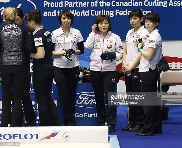 Sayaka Yoshimura, Ayumi Ogasawara, Anna Ohmiya and Kaho Onodera of Japan react during a round-robin match between Japan and Russia during day four of...