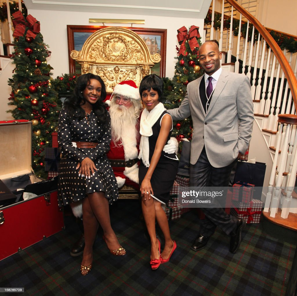 Saycon Sengbloh, Valisia Lekae and Brandon Victor Dixon (cast members from the upcoming Broadway musical Motown: The Musical)pose with Santa Claus during The Brooks Brothers Hosts Seventh Annual Holiday Celebration To Benefit St Jude Children's Research Hospital on December 12, 2012 in New York City.