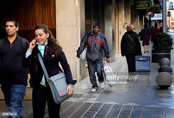 Saydou Yallo from the Guinean capital of Conakry walks the street November 20 2008 in Jaen Spain Yallo who arrived by cayuco to the Spanish island of...