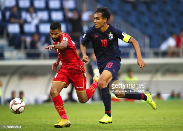 Sayed Dhiya Saeed of Bahrain competes with Teerasil Dangda of Thailand during the AFC Asian Cup Group A match between Bahrain and Thailand at Al...