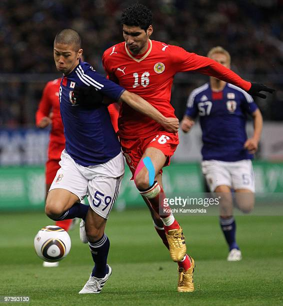 Sayed Mohamed Adnan of Bahrain competes with Takayuki Morimoto of Japan during the AFC Asian Cup Qatar 2011 Group A qualifier football match between...