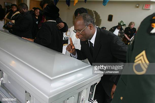 Saying goodbye tp Oprince Teewia A Liberian immigrant killed in Iraq at his funeral service in Newark Delaware January 13 2006These images are part...
