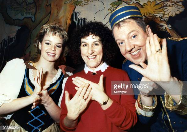 Saying Happy New Year in sign language two of the cast of the Darlington Civic Theatre panto Cinderella Nikki Ellen and Jimmy Cricket with Cathy...