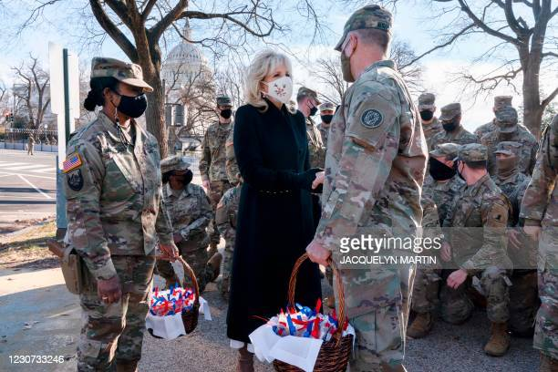 Saying, The Bidens are a National Guard family, first lady Jill Biden greets members of the National Guard with chocolate chip cookies outside the...