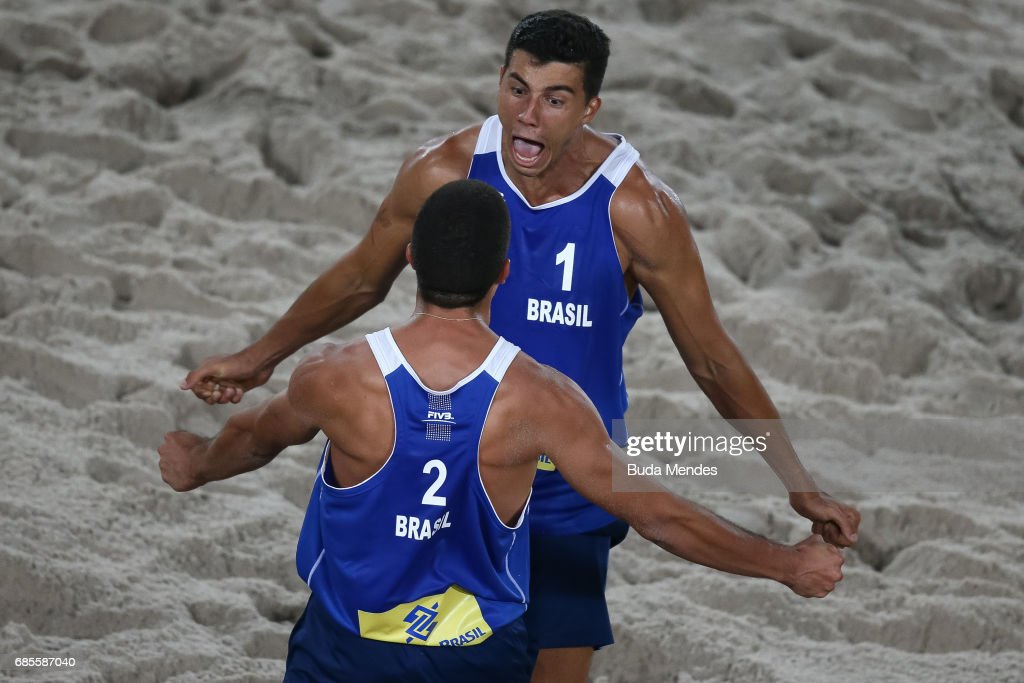 Saymon Barbosa Santos #1 and Alvaro Morais Filho of Brazil celebrate the victory after the Men's Round of 02 match against Andre Loyola Stein and Evandro Gonalves Oliveira Junior of Brazil at Olympic Park during day two of the FIVB Beach Volleyball Rio Grand Slam, on May 19, 2017 in Rio de Janeiro, Brazil.