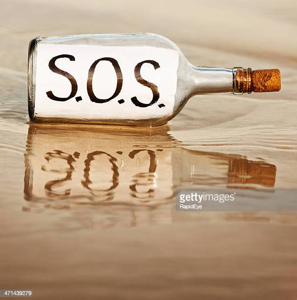 SOS says desperate message in bottle at waters edge