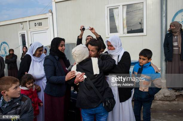 'M' says goodbye to her relatives as she and her brother Shamoo prepare to leave for Germany with a resettlement program to bring roughly 1000...