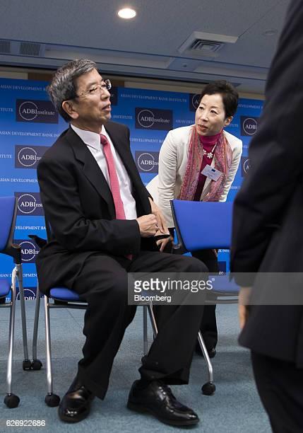 Sayuri Shirai, professor at Keio University, right, speaks with Takehiko Nakao, president of the Asian Development Bank, after a photo session at the...
