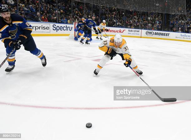 sb27 and Nashville Predators leftwing Viktor Arvidsson skate after a loose puck during a NHL game between the Nashville Predators and the St Louis...