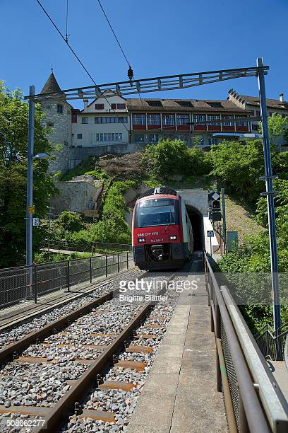 SBahn of the SBB coming out of tunnel under Castle Laufen in Schaffhausen