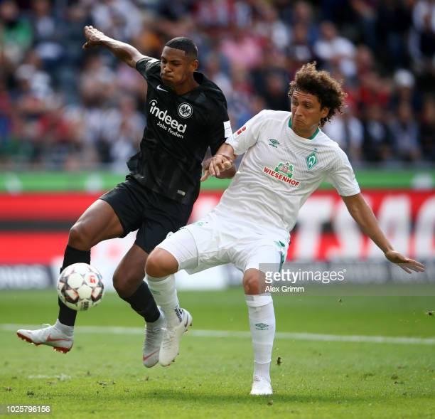 Sébastien Haller of Eintracht Frankfurt battles for possession with Milos Veljkovic of Werder Bremen during the Bundesliga match between Eintracht...