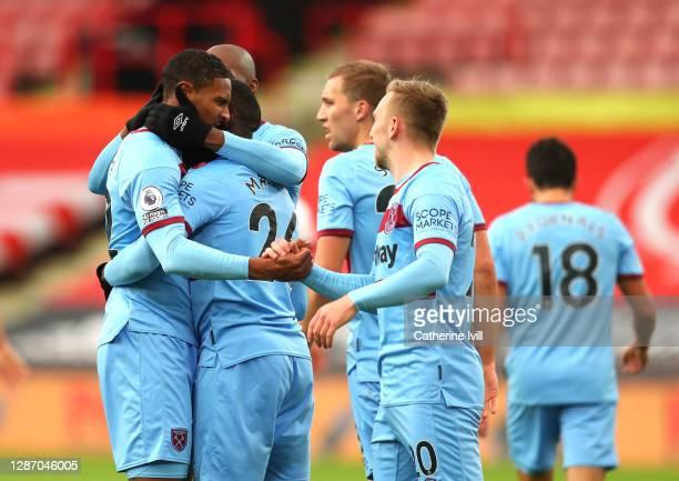 Sébastien Haller of West Ham United celebrates after scoring their sides first goal with Arthur Masuaku of West Ham United and Jarrod Bowen of West...