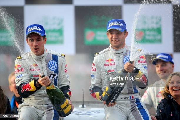 Sébastien Ogier and Julien Ingrassia of France and Volkswagen Motorsport celebrate victory on the podium after the Great Orme stage of the FIA World...