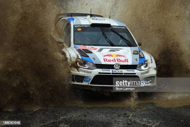 Sébastien Ogier and Julien Ingrassia of France drive the Volkswagen Polo R WRC through a watersplash on the Sweet Lamb stage of the FIA World Rally...