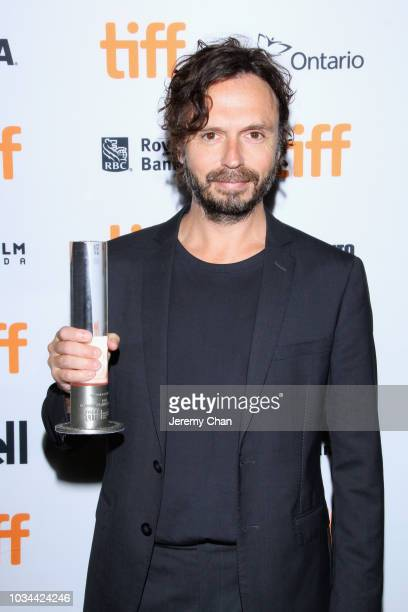 Sébastien Pilote poses with the Canada Goose Award for Best Canadian Feature Film for 'The Fireflies Are Gone' at the 2018 TIFF Awards Ceremony at...