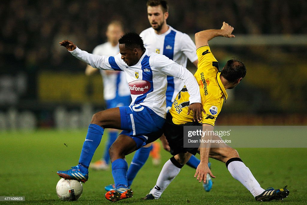 SBoldiszar Bodor of NAC and Renato Ibarra of Vitesse battle for the ball during the Eredivisie match between NAC Breda and Vitesse at the Rat Verlegh Stadion on March 8, 2014 in Breda, Netherlands.