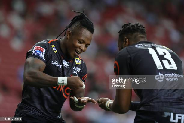 Sbu Nkosi of Sharks celebrates after scoring a try with Lukhanyo Am during the Super Rugby match between Sunwolves and Sharks at Singapore National...