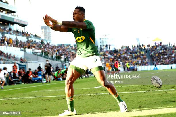 Sbu Nkosi of South Africa celebrates after scoring a try during the Rugby Championship match between the New Zealand All Blacks and the South African...
