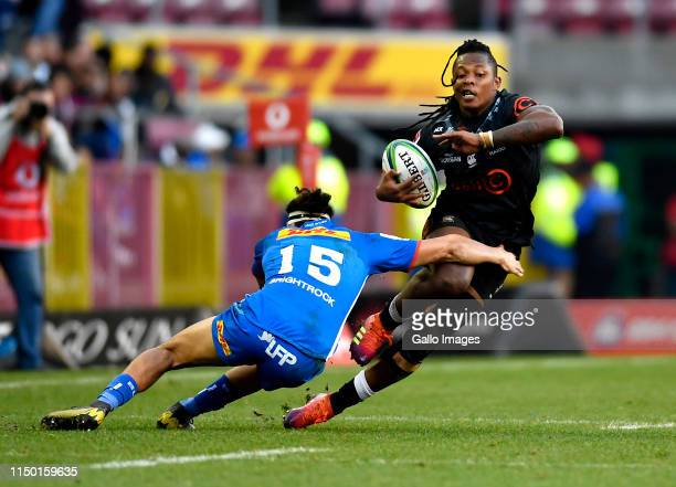 Sbu Nkosi of The Sharks tackled by Dillyn Leyds of the Stormers during the Super Rugby match between DHL Stormers and Cell C Sharks at DHL Newlands...