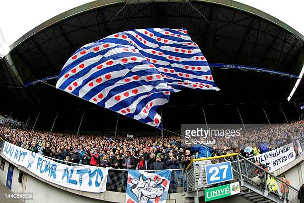 sc Heerenveen supporters wave a flag with the Frisian colours during the Dutch Eredivisie match between sc Heerenveen and Feyenoord held on May 6...
