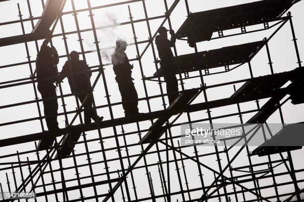 Scaffold builders erect scaffolding on a bridge construction site in Hafencity in HamburgGermany 25 January 2017 Photo Christian Charisius/dpa  ...