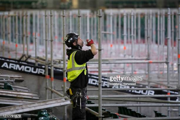 Scaffolder takes a break to drink water in the Dragon's Heart hospital on April 9 in Cardiff, Wales. The Principality Stadium is being converted into...