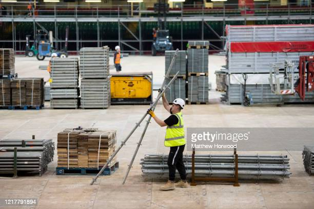 Scaffolder works in the Dragon's Heart hospital on April 9 in Cardiff, Wales. The Principality Stadium is being converted into 2000-bed field...