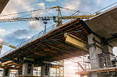 Scaffolding and crane in the construction of a bridge for a highway