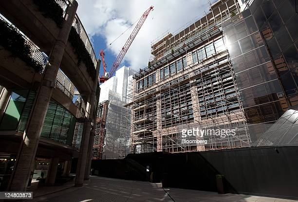 Scaffolding and protective covers stretch across number 5 Broadgate as development continues on the new London headquarters for UBS AG at the site...
