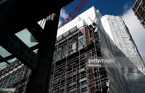 Scaffolding and protective covers stretch across the side of number 4 Broadgate as development continues on the new London headquarters for UBS AG at...