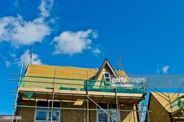 scaffolding around a roof - replacement stock pictures, royalty-free photos & images